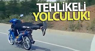 Yatarak tek elle motosiklet kullandı